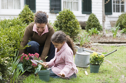 a woman gardening with her daughter